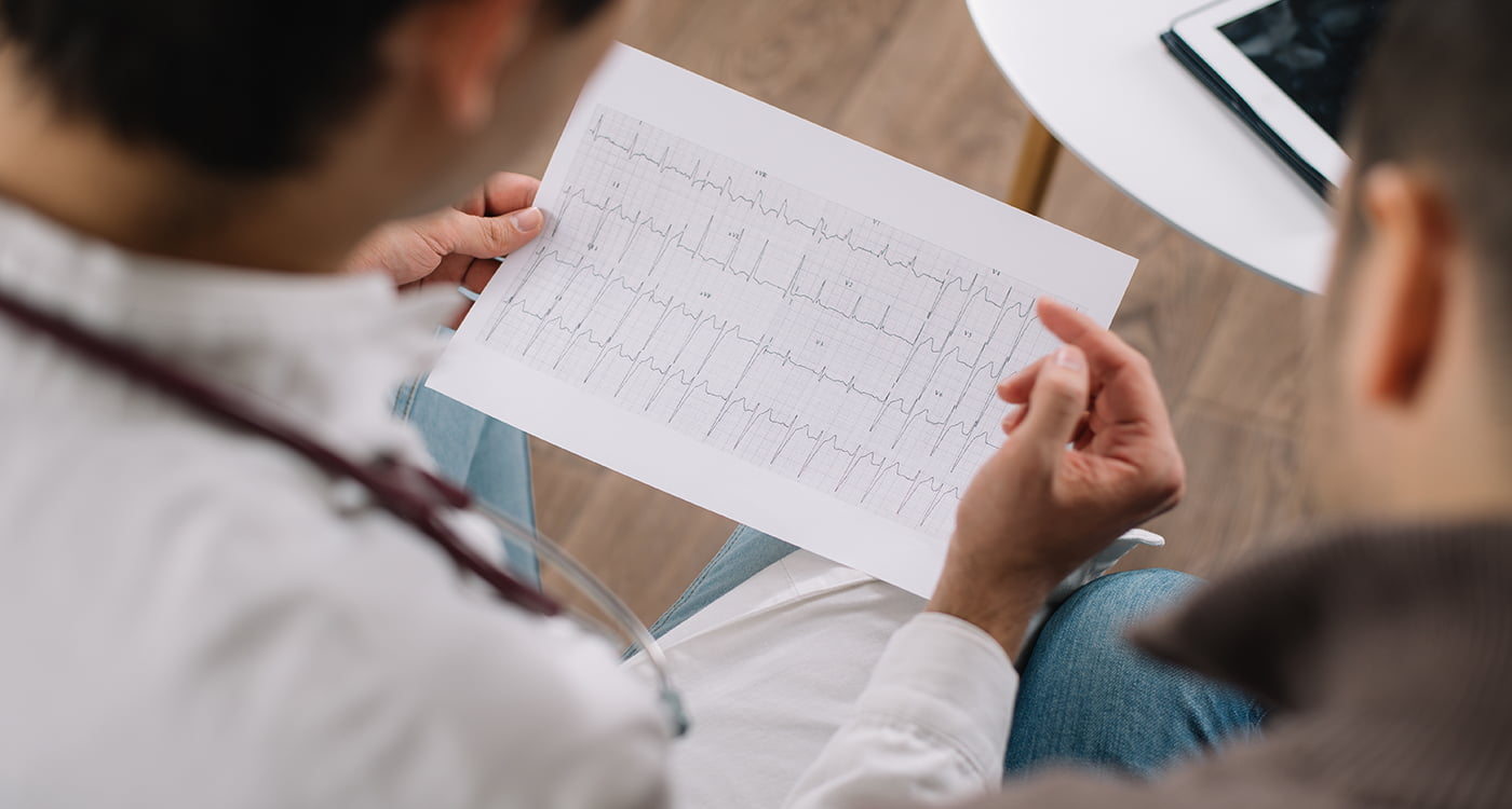 a doctor looking at an ekg printout