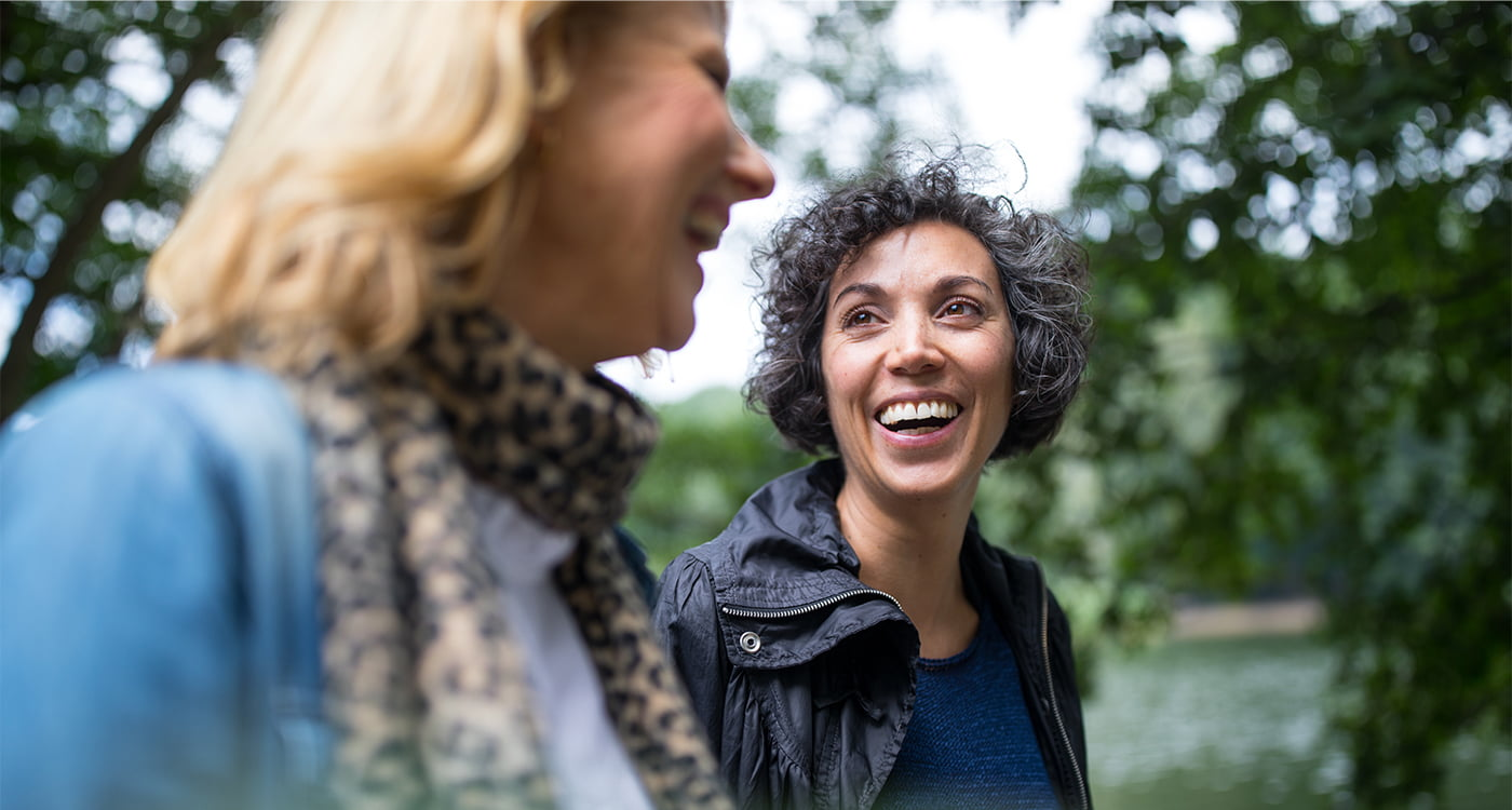 a woman laughing with her friend