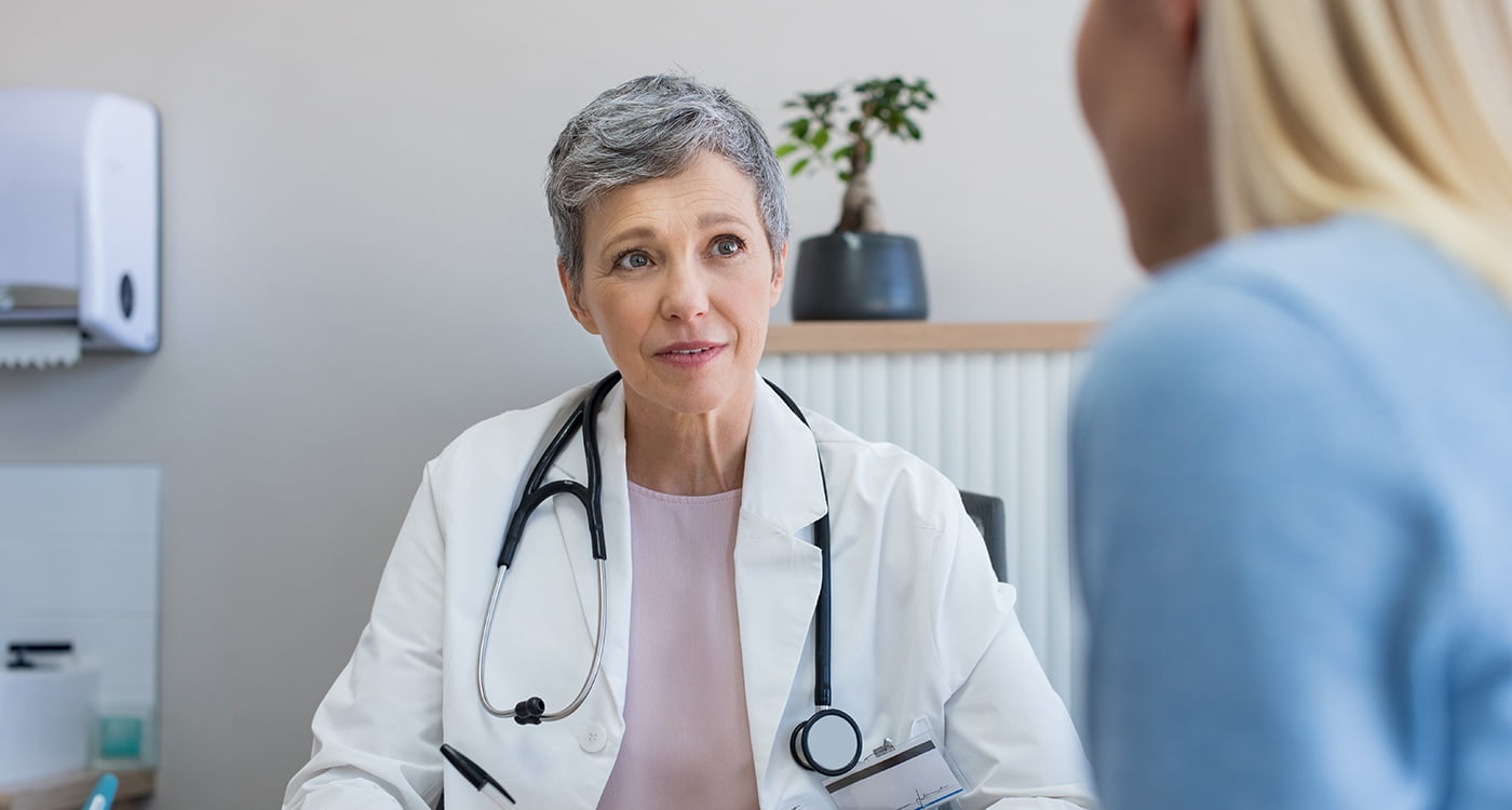 a doctor talking to her patient